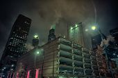 Dark and gritty Chicago city skyline at night during fog poster