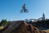 Bmx Bike Jump Over A Dirt Trail On A Dirt Track. poster