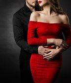 Couple Fashion Beauty, Young Woman In Sexy Red Dress And Embracing Man In Love poster