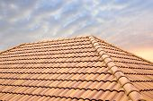 Roof Tiles And Sky Sunlight.roofing Contractors Concept Installing House Roof. poster