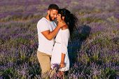Couple In Love On Lavender Fields. Boy And Girl In The Flower Fields. Honeymoon Trip. Honeymoon. New poster