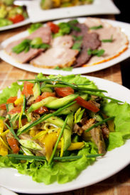 picture of gourmet food  - Served in white plates salad and snack on a table - JPG
