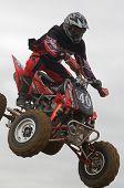 Atv Motocross Rider Over A Jump