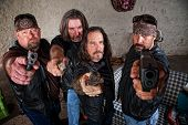 picture of redneck  - Group of four bikers in leather jackets brandishing weapons - JPG