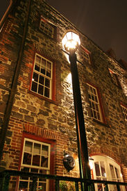 picture of lamp post  - a lamp post by a brick building - JPG