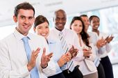 Successful business group applauding at the office