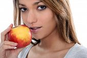 young sensual woman is going to eat an apple