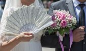 Hand Of The Bride With A Fan