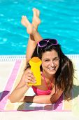 picture of suntanning  - Funny woman sunbathing on summer at swimming pool - JPG