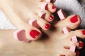 stock photo of painted toenails  - foot pedicure applying woman