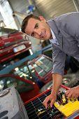 Portrait of coachbuilder standing in autoshop