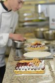 Pastry cook student making cake