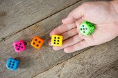 Hand Throwing Colorful Dice