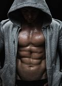 stock photo of stomach  - Close up of muscular sports man after weights training - JPG