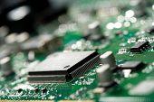 Microchip On Green Circuit Board