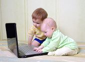 Little Girl And Boy Using Laptops.