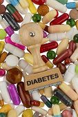 stock photo of diabetes mellitus  - stamp on colorful tablets - JPG