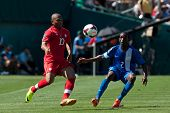 PASADENA, CA - JULY 7: Simeon Jackson #10 of Canada & Nicolas Zaire #2 of Martinique during the 2013