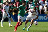 PASADENA, CA - JULY 7: Marco Fabian #10 of Mexico and Gabriel Gomez #6 of Panama during the 2013 CON