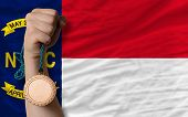 Bronze Medal For Sport And  Flag Of American State Of North Carolina