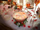 stock photo of bridal shower  - a nicely decorated bridal shower table with the festive punch as the center of attention - JPG