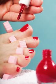 foto of painted toes  - foot pedicure applying woman - JPG