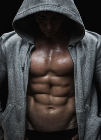 foto of hooligan  - Close up of muscular sports man after weights training - JPG