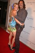 Christine Marcello and Lorenzo Lamas at the Archstone Luxury Summerfest Rooftop Pool Party, Archstone, Santa Monica, CA. 08-15-09 Photo by