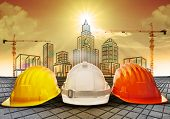 pic of engineer  - safety helmet and building  construction sketching on paper work use for construction industry business and architecture engineering topic - JPG