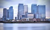stock photo of canary  - Canary Wharf buildings overlooking the river thames