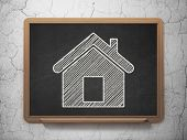 Business concept: Home on chalkboard background