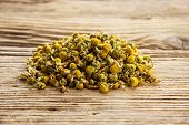 Dry Camomile On  Old Wooden Table