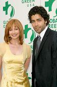 Sharon Lawrence and Adrian Grenier  at Global Green USA's 13th Annual Millennium Awards. Fairmont Miramar Hotel, Santa Monica, CA. 05-30-09