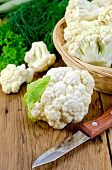 Cauliflower With A Basket And Knife On Board