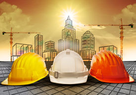 picture of sketche  - safety helmet and building  construction sketching on paper work use for construction industry business and architecture engineering topic - JPG