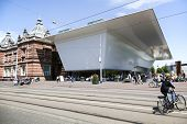 People Walking Or Cycling Along New Part Of Stedelijk Museum