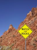Watch For Rocks Sign Next To Highway