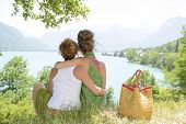 stock photo of lesbian  - two lesbians in nature admire the lake of Annecy - JPG