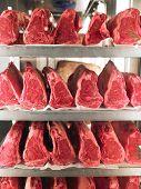 Rows Of Steak On Metal Racks