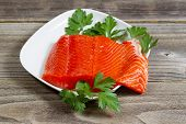 Fresh Salmon Fillet In White Dish On Rustic Wood