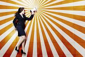 Funny image of businesswoman running with megaphone in hands