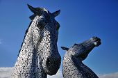 Two Horses Heads Made Of Steel.