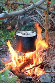 smoked kettle on tourist camp fire