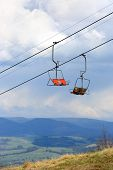 ski chairlift in spring mountains background