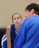 Young girl in basketball huddle