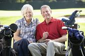 Senior couple on golf course