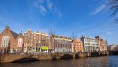 Amsterdam, Netherlands - March 19, 2014: Colorful Houses On The Canal In Spring Sunny Day. Ordinary