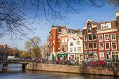 Amsterdam, Netherlands - March 19, 2014: Colorful Houses Facades On The Canal In Spring Sunny Day. O