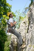 Young Man Climbing A Rock Wall