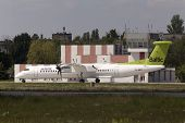airBaltic De Havilland Canada DHC-8-402Q Dash 8 aircraft running on the runway